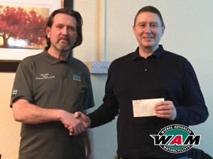 Chris (right) receiving the cheque for £1000.00 from club Chairman, Ken Smith